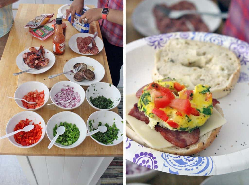 Photo collage showing two photos side-by-side. The photo on the left shows a wooden table holding several white bowls filled with toppings such as chopped veggies, herbs, and bacon. The right photo shows an open breakfast sandwich on a paper plate.