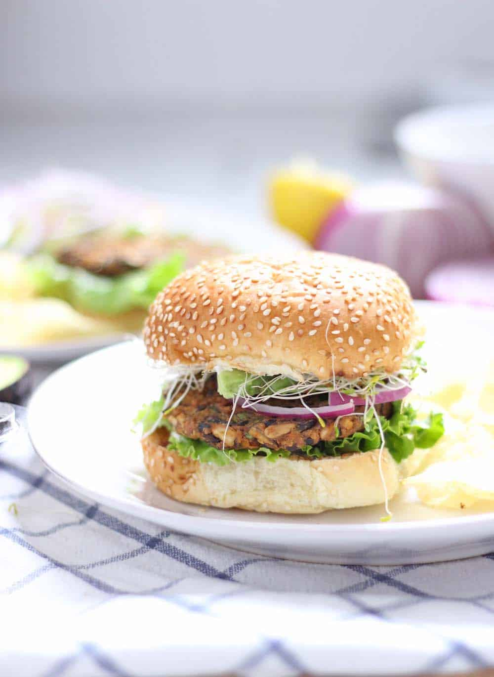 Sweet Potato and Black Bean Veggie Burgers | These veggie burgers are full of flavor and amazingly healthy. They have a great texture and they hold up well when you bake them without being dry or mushy! And they are SO easy to make!