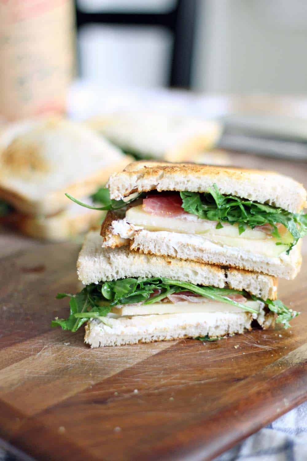 Apple and Prosciutto Sandwich with Goat Cheese and Arugula | This sandwich is the PERFECT combination of sweet, salty, tangy, and peppery. It takes 5 minutes to make and it's light and healthy, but will leave you feeling full and satisfied!