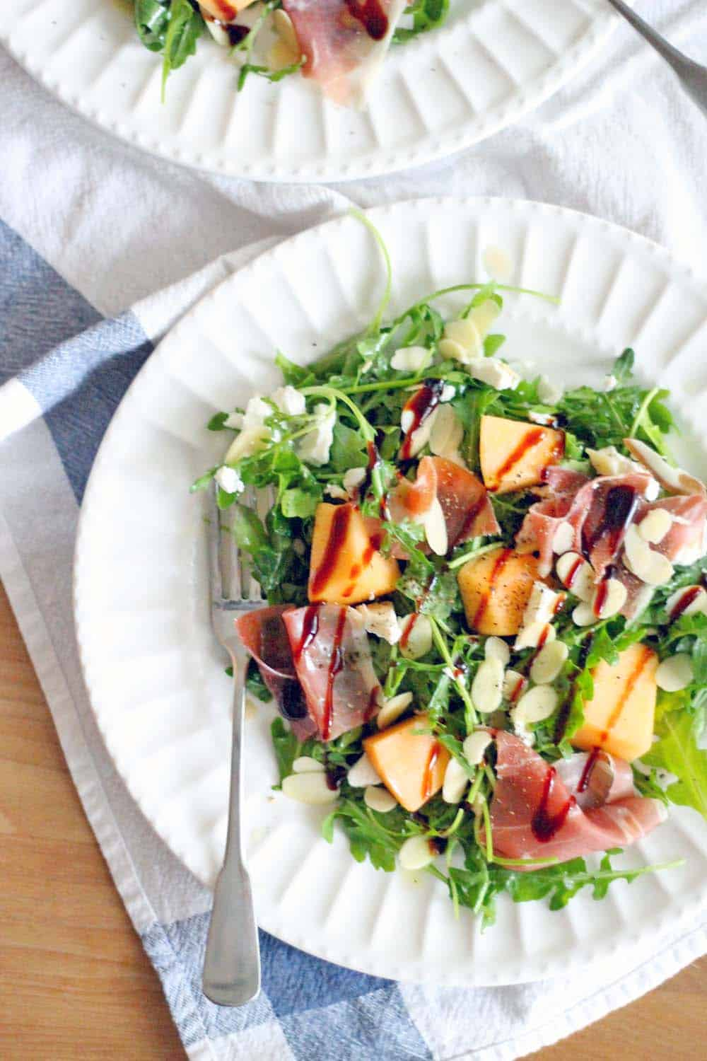 Arugula, Cantaloupe, and Prosciutto Salad with Goat Cheese and Almonds | This salad is a great savory way to enjoy cantaloupe with a great salty, sweet, and tangy balance- and it's satisfying enough to enjoy as a meal!