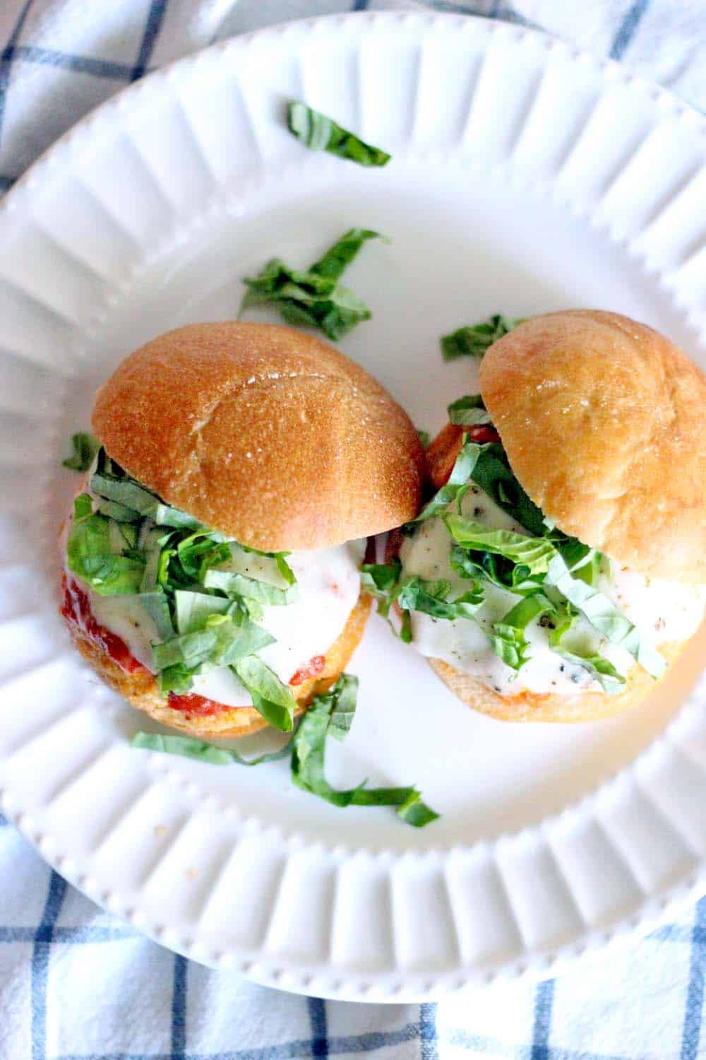 These Chicken Parmesan Sliders are easy, freezable for later, and can easily feed a crowd. Absolutely DELICIOUS- it's like a burger and chicken Parmesan had a baby!