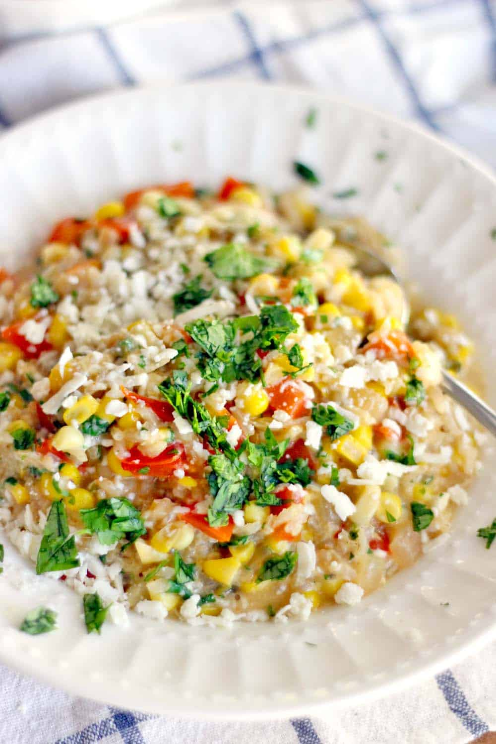 This easy brown rice risotto has a Mexican twist with red bell and jalapeno peppers, sweet fresh corn, and cotija cheese melted into every bite. Delicious as a side or as a main course!