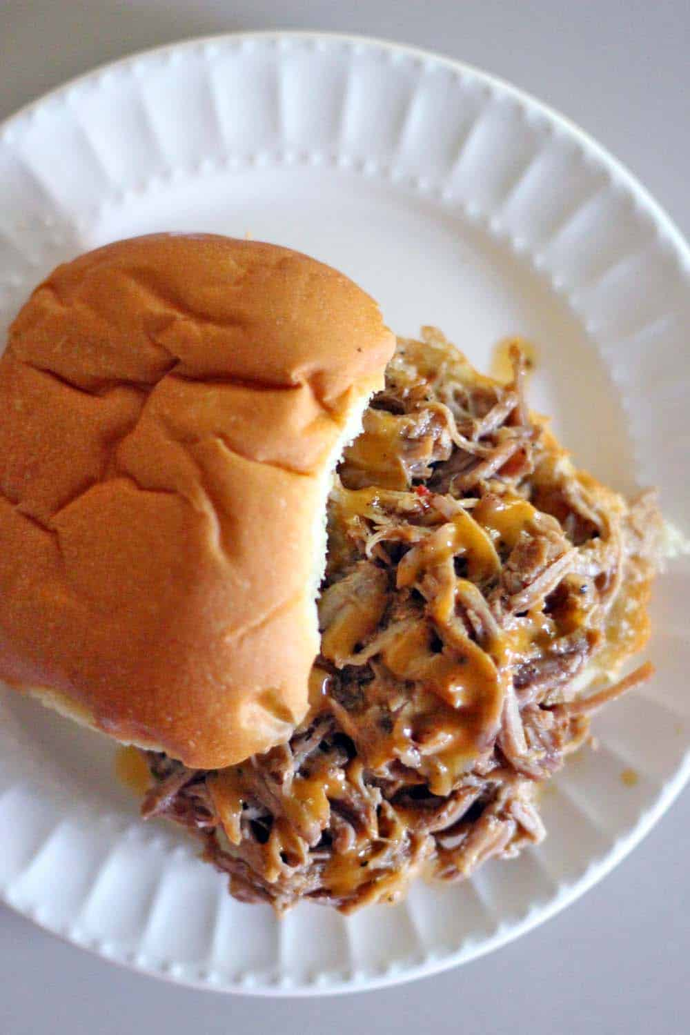 These easy slow cooker pulled pork sandwiches take only FIVE MINUTES of prep and use only FIVE INGREDIENTS- including buns! Great for feeding a crowd or for freezing for later meals.