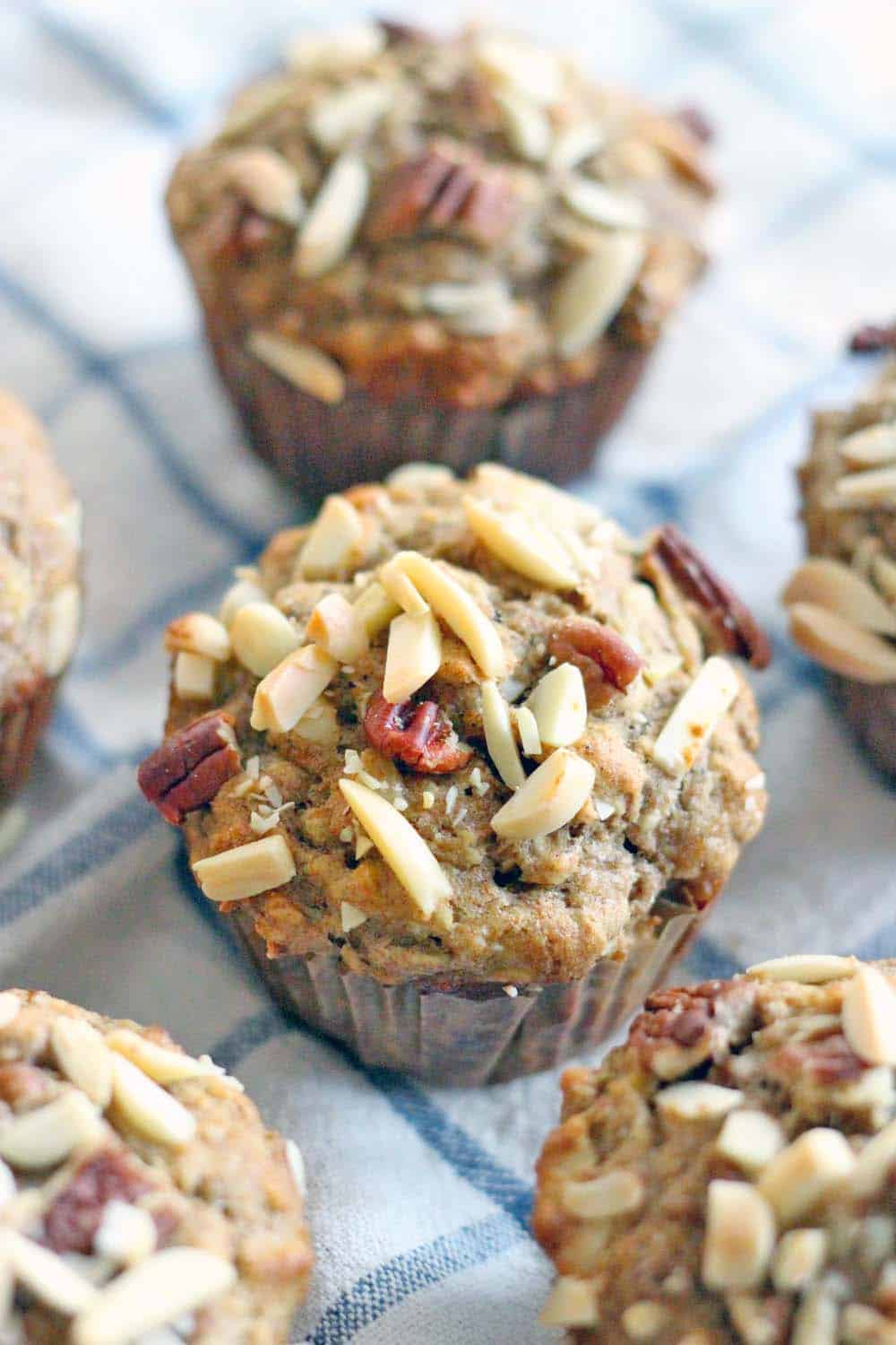 Whole Wheat Banana Oat and Toasted Nut Muffins   These muffins are 100% whole grain and guilt-free, packed full of nuts for protein and banana for natural sweetness. They are moist, delicious, and can be made in bulk and frozen for easy busy morning breakfasts!