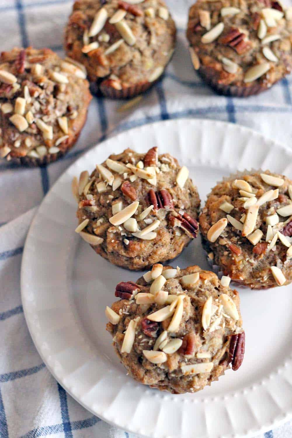 Whole Wheat Banana Oat and Toasted Nut Muffins | These muffins are 100% whole grain and guilt-free, packed full of nuts for protein and banana for natural sweetness. They are moist, delicious, and can be made in bulk and frozen for easy busy morning breakfasts!
