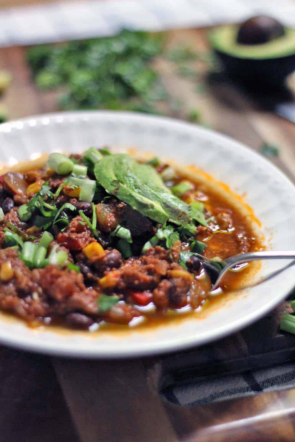 A secret ingredient in this healthy, low carb, vegetable packed turkey chili makes it super velvety and rich- it's the most delicious thing to come home to after a long day of work!