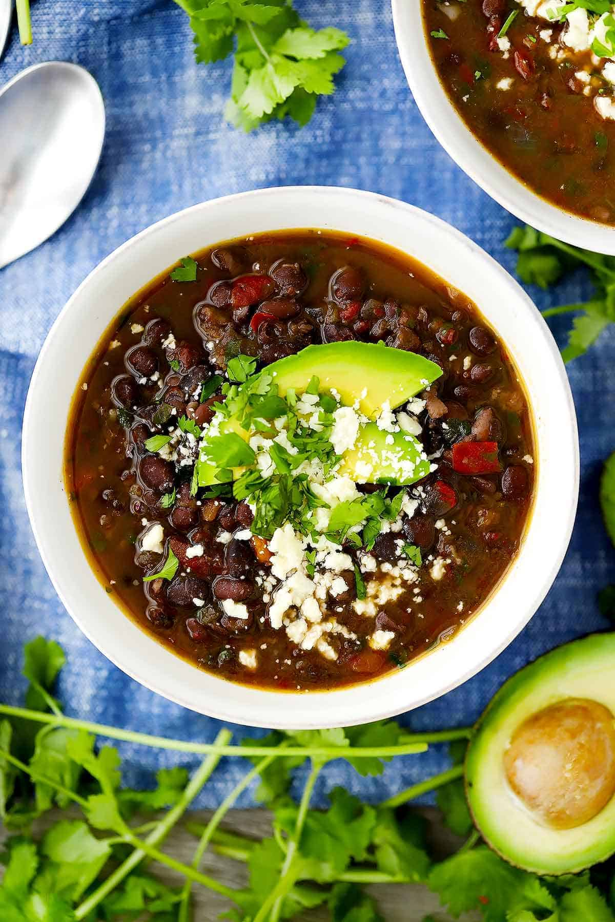 An overhead vertical image of a bowl of black bean soup.
