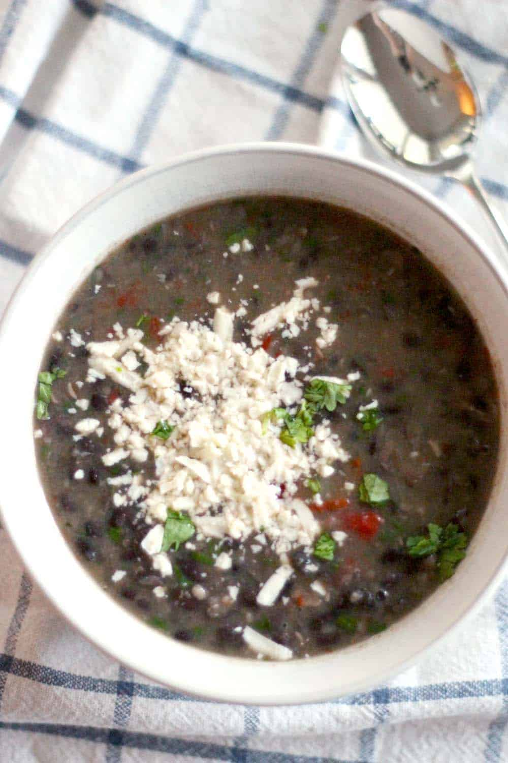 Smoky Slow Cooker Black Bean Soup | This soup is hearty, healthy, and absolutely delicious, and takes only 5 minutes of prep! Let your Crockpot do the work for you. Vegan/vegetarian optional.