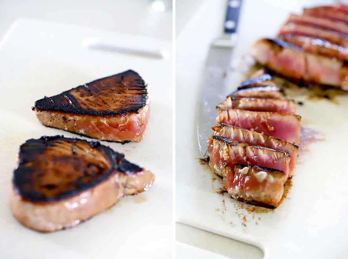 Ahi tuna steaks cut into slices on a cutting board