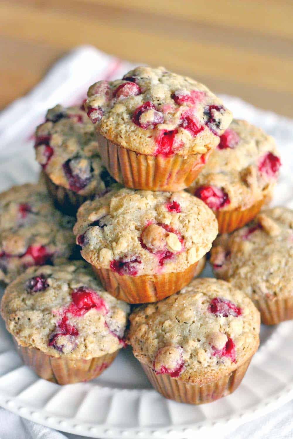 These whole wheat cranberry ginger pecan muffins are healthy, hearty, and oh so tasty! Perfect for Christmas morning, using the leftover fresh cranberries from Thanksgiving you have stored in your freezer!