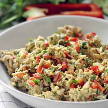A bowl of fiesta chicken salad made with avocados and bell peppers