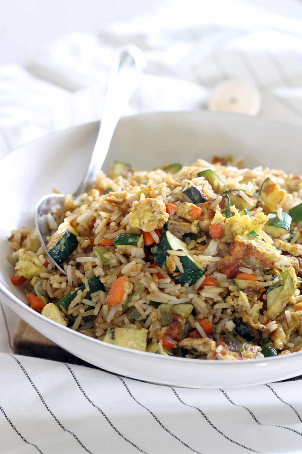 Ten minutes and six ingredients is all you need for this fresh, delicious veggie fried rice that's MUCH healthier than take-out!