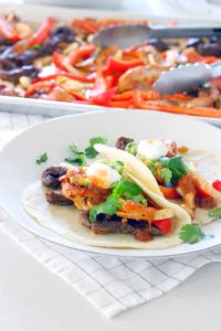 These oven baked steak and chicken fajitas are tender, bursting with flavor, and are an easy, no-fuss weeknight dinner the whole family will love!