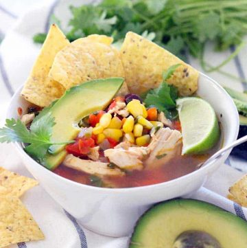 Healthy, easy, and DELICIOUS- this one pot chicken tortilla soup has a spicy kick and tastes super fresh. Make a double batch and freeze one!