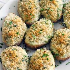 Creamy on the inside, crunchy breadcrumb topping on the outside- these are the BEST twice baked potatoes EVER! Plus, they're freezable if you assemble ahead of time or have leftovers. They're my late grandfather's famous family recipe.