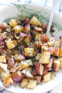 These Roasted Potatoes and Onions are PERFECT. They're mixed with onions that caramelize, rosemary, and whole grain mustard that adds a subtle kick. The perfect side for anything from a casual weeknight dinner to Thanksgiving!