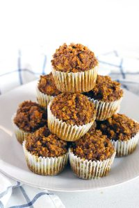 These Gluten Free Pumpkin Oat Muffins are packed with healthy ingredients like oats, pumpkin, and walnuts. They're more like a delicious energy bar than a muffin, and are the perfect hearty grab and go breakfast.