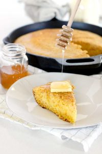 This honey skillet cornbread is a Southern classic- slightly sweet, moist, and with caramelized edges from the cast iron skillet. It's the ONLY way to cook cornbread!