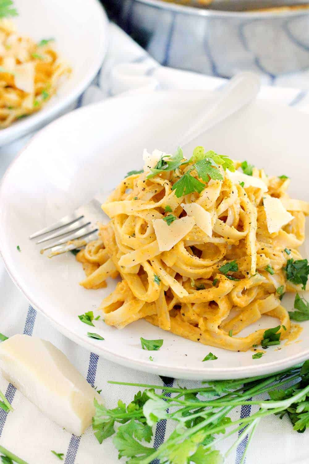 With 60% fewer calories than traditional Alfredo sauce, this Pumpkin Fettucini Alfredo is healthy, creamy, and delicious. It's a great way to sneak veggies into a main course, especially in the fall season!