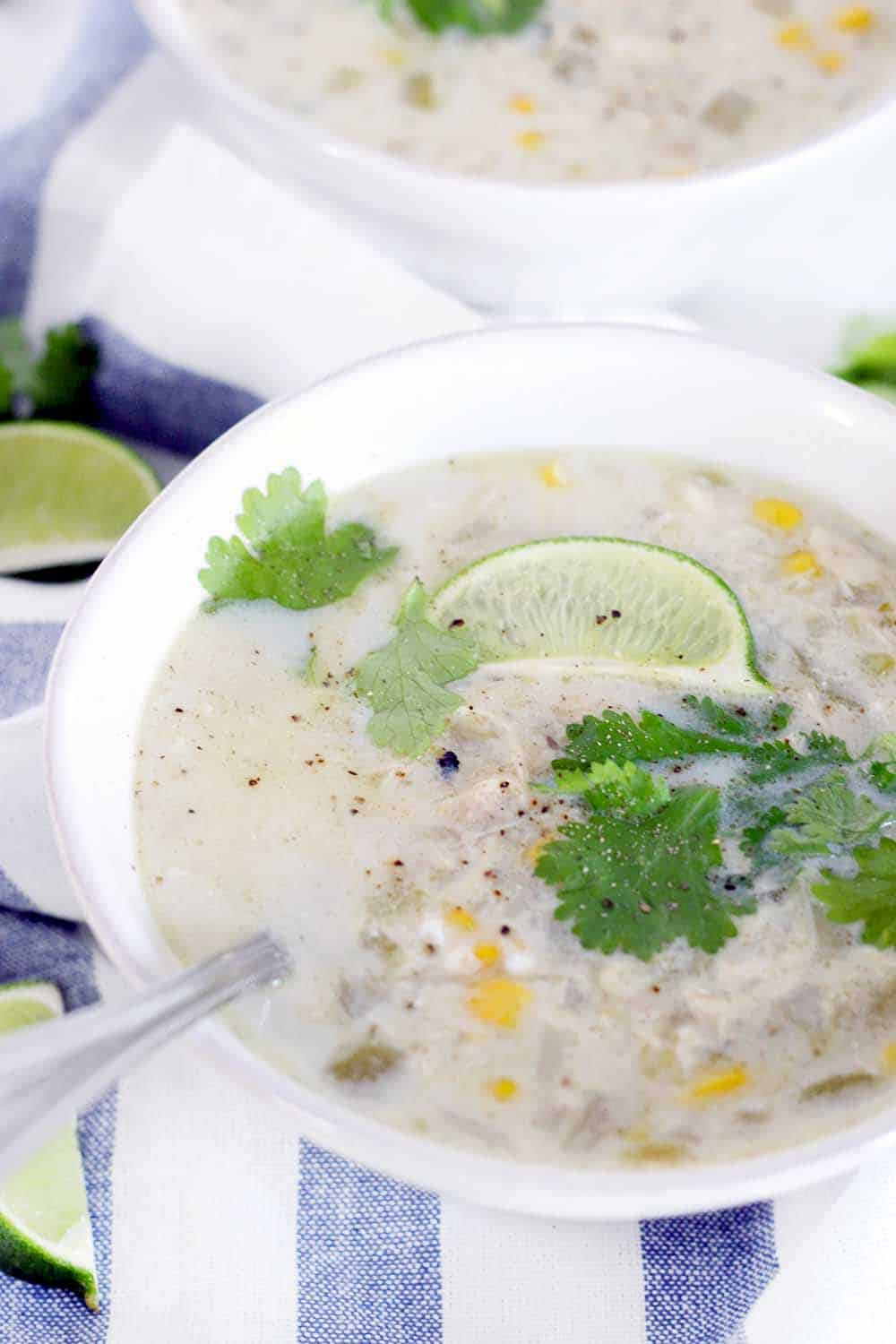 This slow cooker white chicken chili is cozy, gluten free, and smells AMAZING while it cooks. Plus, you can easily make it dairy and grain free!