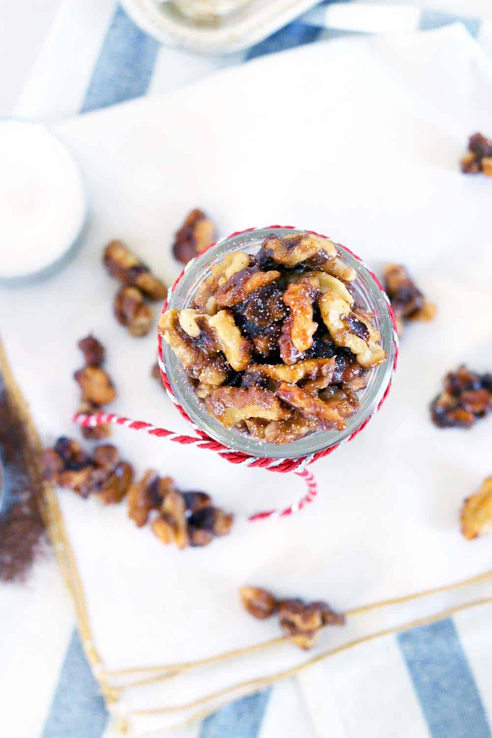 This candied walnut recipe takes only 5 minutes and 5 ingredients! Eat as a sweet treat, toss with a salad, or serve on a cheese board. Perfect as a holiday gift packaged in mason jars. | www.bowlofdelicious.com