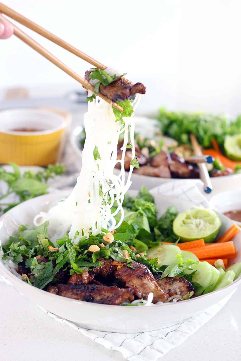 This recipe for Vietnamese Pork Bún Bowls uses a few shortcuts to make it quick and easy without sacrificing flavor. It's fresh, healthy, gluten free, and adaptable to be vegan/vegetarian! | www.bowlofdelicious.com