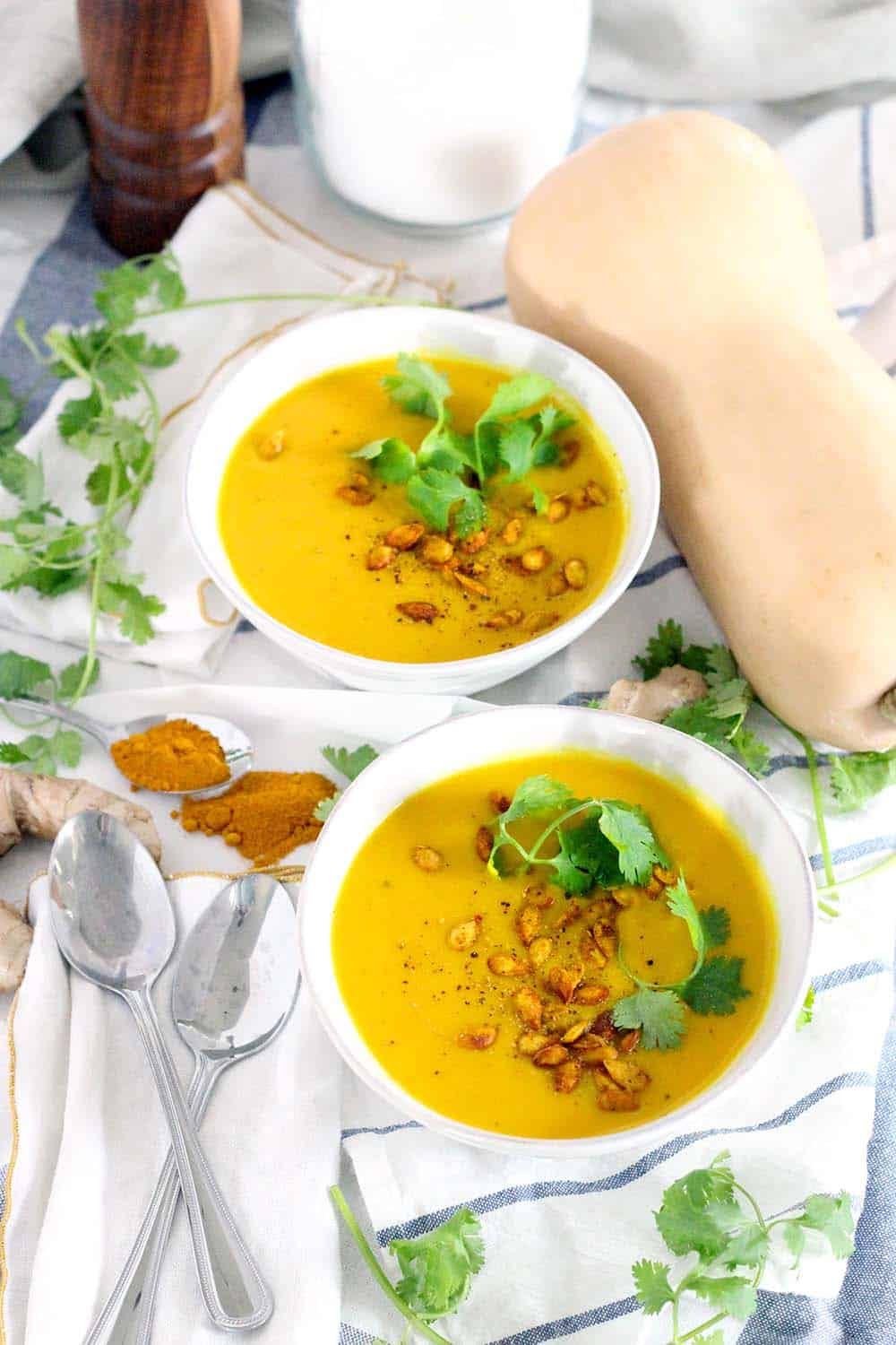 This Ginger Turmeric Butternut Squash Soup is full of healing, healthy ingredients. It's warm, deliciously bright, vegan, low carb, Paleo, and Whole30 compliant!