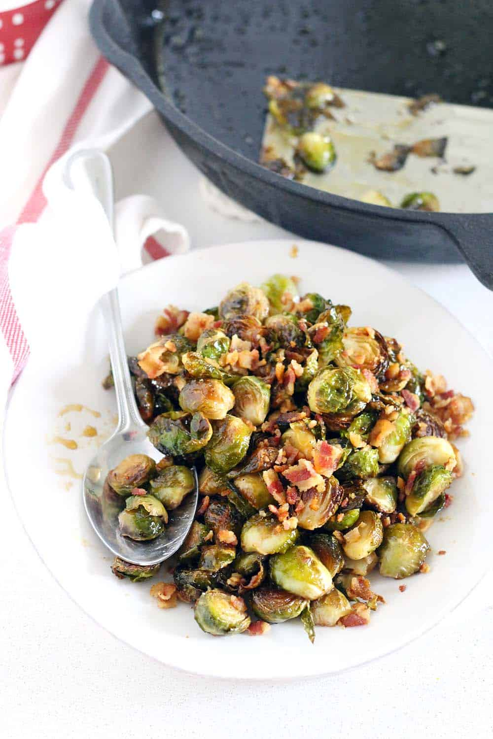 Maple Roasted Brussels Sprouts and Bacon- this recipe for Brussels sprouts is my favorite!! It's paleo, crispy roasted, slightly smoky from the bacon, and slightly sweet from the pure maple syrup. | www.bowlofdelicious.com