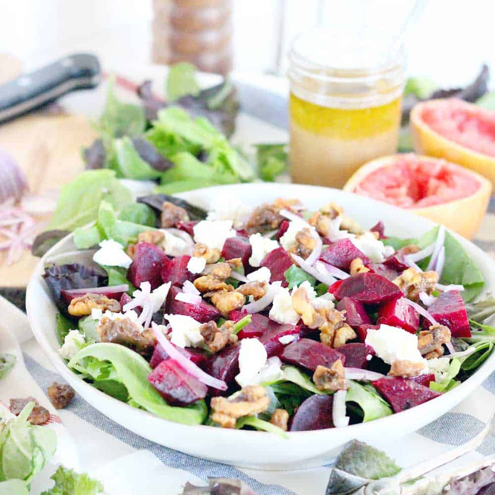 This healthy Roasted Beet Salad with Grapefruit Vinaigrette is the perfect thing to enjoy year round or as a colorful side for the holidays. Packed with goat cheese and candied walnuts, the ingredients combine to make the most perfect salad combination EVER! | www.bowlofdelicious.com