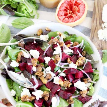 This healthy Roasted Beet Salad with Grapefruit Vinaigrette is the perfect thing to enjoy year round or as a colorful side for the holidays. Packed with goat cheese and candied walnuts, the ingredients combine to make the most perfect salad combination EVER!   www.bowlofdelicious.com