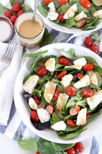 This Creamy Maple Balsamic Dressing is tangy, slightly sweet, and perfectly creamy. It's my new favorite salad dressing recipe! Toss with mixed greens, or drizzle on a Caprese salad.