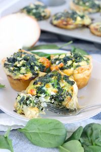 These Mini Spinach Feta pies are an easy alternative to traditional Greek Spanakopita, with only 5 ingredients and 10 minutes of hands on time! These are packed FULL of healthy spinach, and a perfect vegetarian entree or appetizer.