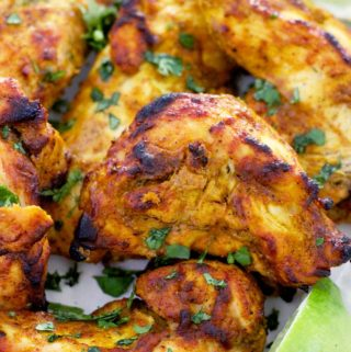 This Oven Broiled Tandoori Chicken is super flavorful, charred, and smoky- just like at your favorite Indian restaurant! This healthy, low carb recipe takes only 20 minutes to cook and is perfect on its own or in your favorite Indian chicken dish.