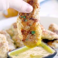 These Paleo Oven-Fried Chicken Tenders are grain-free and gluten-free, easy to make, and kid-friendly with a simple honey mustard dipping sauce. Perfect for game day or a casual weeknight dinner!