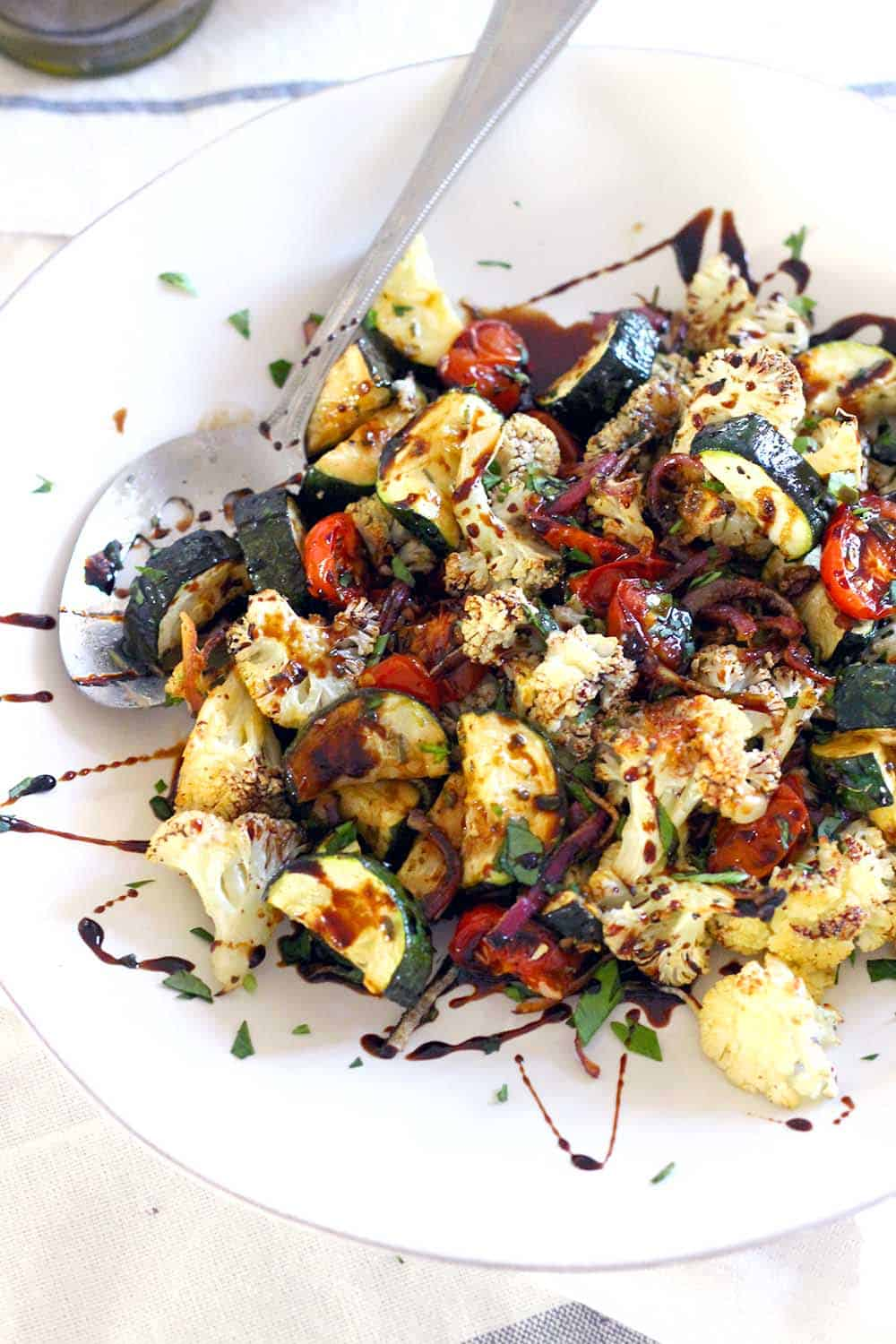 Herb Roasted Vegetables with Balsamic Reduction is the perfect healthy side recipe- they're low carb, paleo/whole30, and bursting with delicious savory, sweet, and tangy flavor!