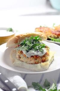 These Salmon Burgers are topped with a Lemon Caper Aioli and are SO easy to make! This recipe is perfect for a healthy alternative to traditional burgers and great for the Lenten season.