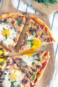 Pizza for breakfast?! Just put eggs on it! This Sausage Breakfast Pizza recipe is perfect for brunch and takes only 20 minutes to make. Use a cast iron pizza pan for best results.