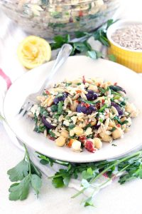 This easy Chickpea and Orzo Salad recipe has all the flavors of the Mediterranean- olives, feta, sun dried tomatoes, and garlic- with an awesome crunch from toasted almonds. It's packed with fiber and nutrients and is great as a side at a potluck or an entire meal.