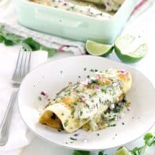 These Chicken and Spinach Enchiladas Verdes are my FAVORITE enchiladas! The recipe is freezable and packed with healthy greens, the chicken is marinated in a delicious jalapeño garlic mixture, and they're topped with jarred roasted tomatillo salsa for a quick and easy shortcut.