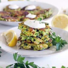 This healthy Shrimp and Zucchini Fritters with Yogurt Sauce recipe is a delicious way to eat your veggies! The yogurt sauce is garlicky with lemon, and the zucchini and shrimp stand out in the simple fritters and are a match made in heaven.