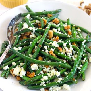 Green Beans Sautéed until crisp-tender, garnished with bleu cheese crumbles and chopped walnuts. This is a delicious way to eat more healthy greens, it takes 10 minutes, and it's healthy, gluten-free, and easy to make. Goes perfectly with anything buffalo flavored!