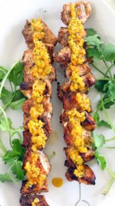 These Grilled Chicken Skewers and are DELICIOUS paired with charred Sweet Pepper Relish! Paleo, low-carb, and gluten-free. Everything cooks on the grill- use any extra relish for hot dogs at your next summer cookout.