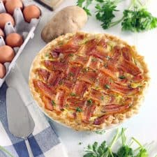 """This decadent Make Ahead Breakfast Pie recipe is made extra special with a Lattice Bacon """"crust"""" on top! This protein- packed meal is great for breakfast, lunch, or dinner, its inexpensive, and it feeds a crowd."""