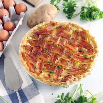 "This decadent Make Ahead Breakfast Pie recipe is made extra special with a Lattice Bacon ""crust"" on top! This protein- packed meal is great for breakfast, lunch, or dinner, its inexpensive, and it feeds a crowd."