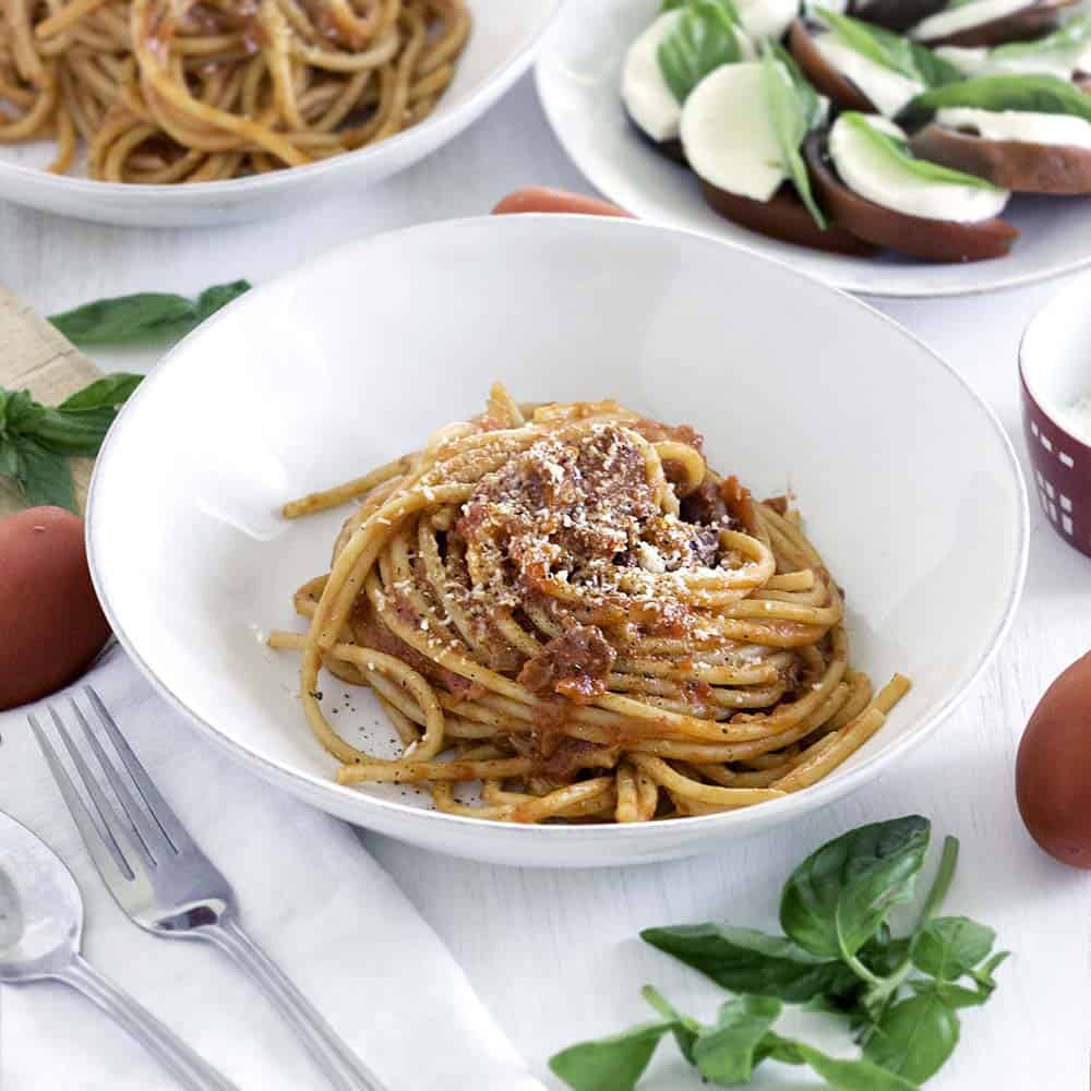 This Bucatini all'Amatriciana recipe is the real deal- authentically made with NO garlic- just a simple tomato sauce and the highest quality ingredients. You can make this amazing Italian pasta from scratch in only 30 minutes!