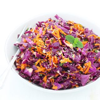 This Thai Sesame Red Cabbage and Carrot Salad recipe is cool, crunchy, healthy, and refreshing. Packed with flavor from fresh mint, basil, and cilantro and a toasted sesame dressing!