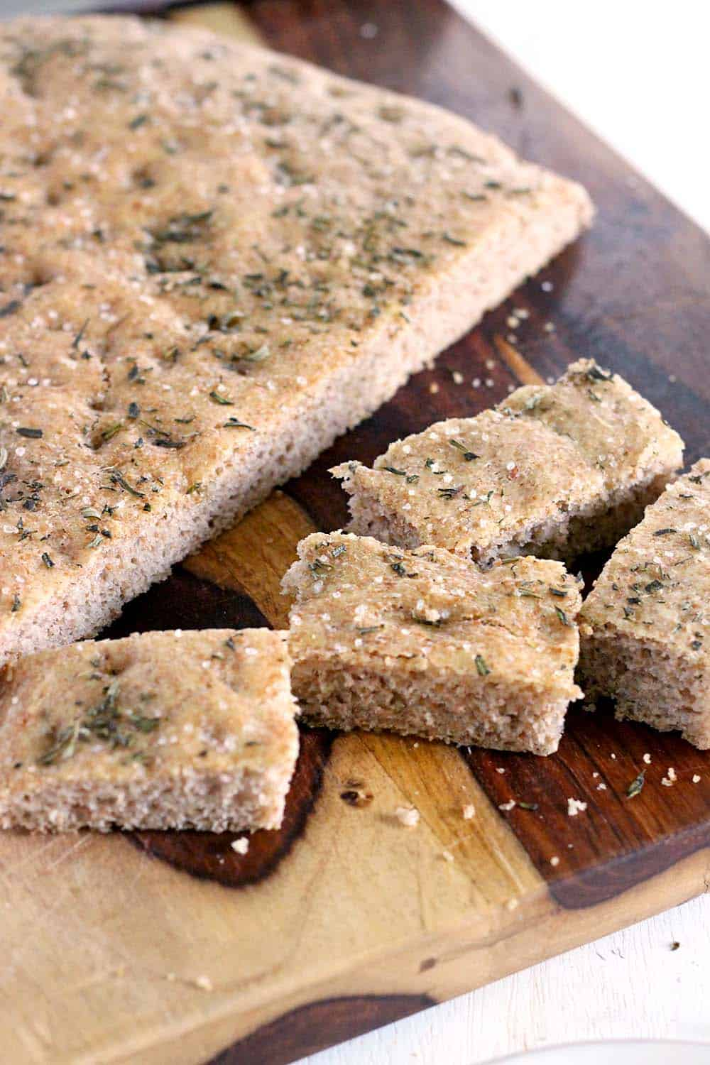 This whole wheat no knead focaccia with rosemary and sea salt is so delicious and easy to make, you'll never need to go to the bakery again!