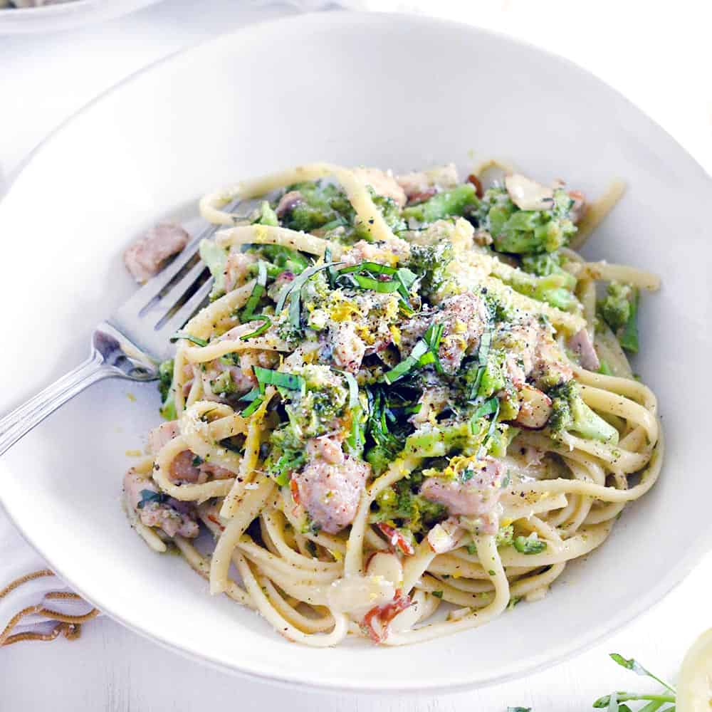 This chicken and broccoli linguine with lemon butter basil sauce recipe is creamy without any milk or cream. Full of bright, fresh flavor and packed with good for you broccoli.