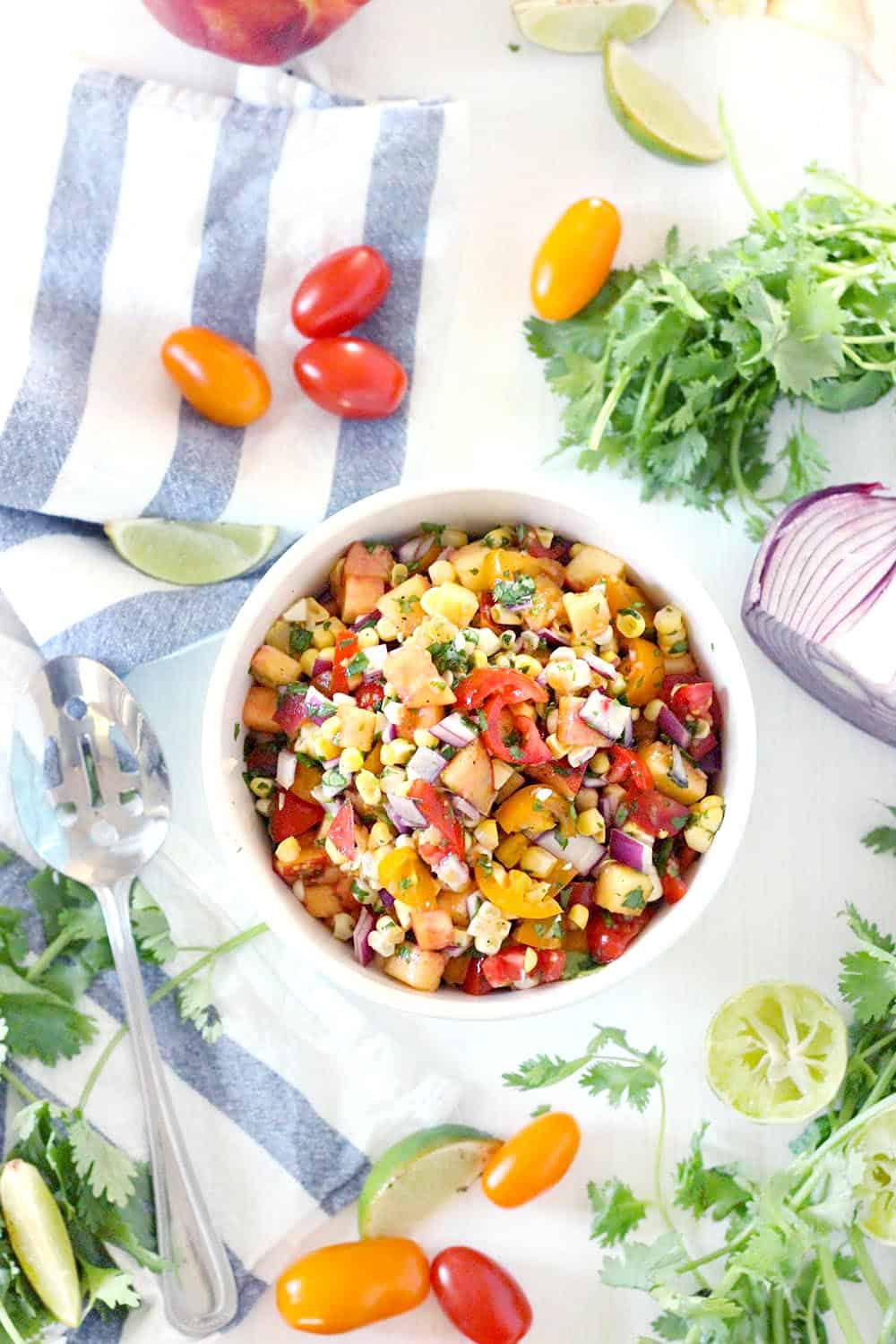Full of fresh summer ingredients, this mild, simple summer peach salsa is great on chips, on tacos, on fish... it's slightly sweet, tangy, and pairs well with spicy, warm flavors. It's healthy, gluten-free, vegan, raw, and low-fat, and it's mild flavor makes it kid friendly.