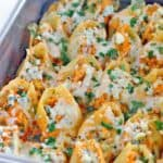 These buffalo chicken stuffed shells are packed with buttery hot sauce and shredded chicken, blue and pepper jack cheeses, and crunchy celery. A decadent make ahead meal for people that LOVE buffalo chicken!